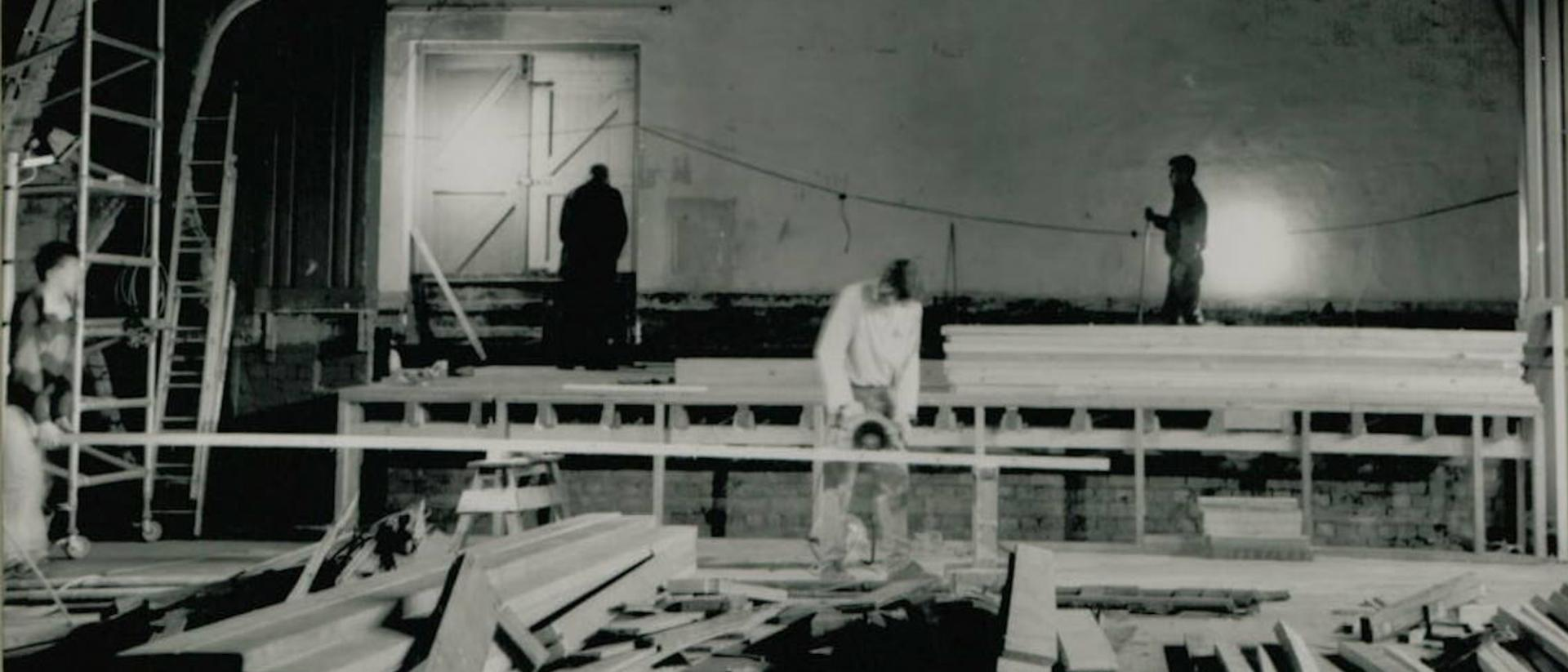 A black and white image of building works being carried out in the auditorium